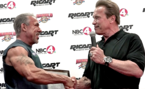 Arnold giving David an award