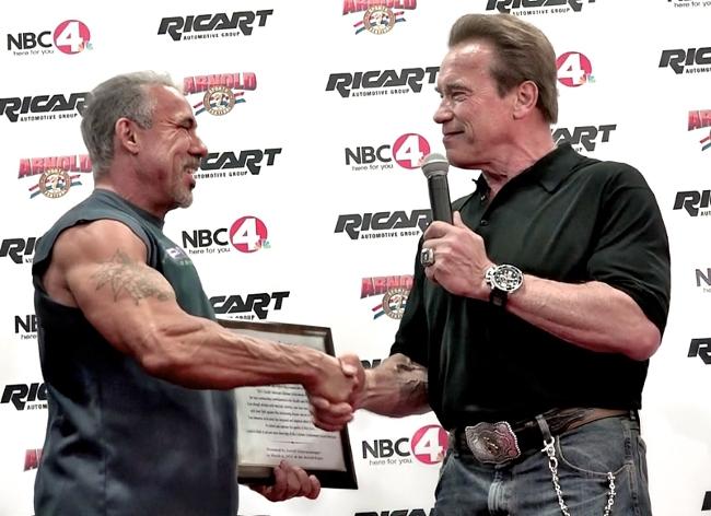 Arnold giving David an award